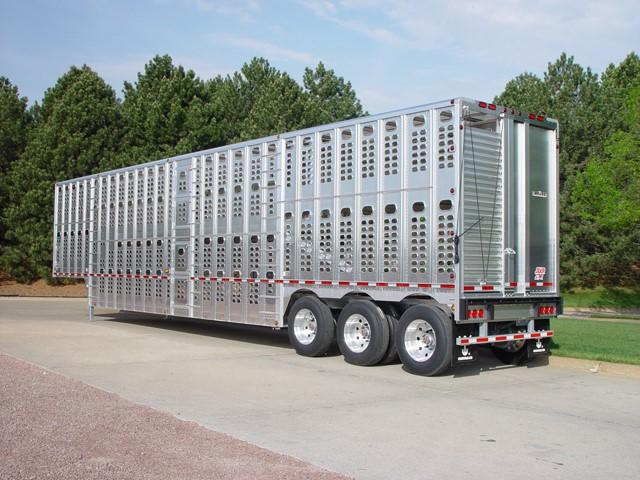 TriAz heavy duty trailer from Wilson Trailer uses BlockDivision pulley blocks for raising & lowering door ramps